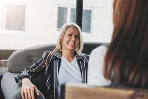 woman smiling talking at intensive outpatient program
