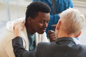 man being comforted in substance abuse treatment