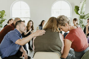 individual getting support in group therapy program